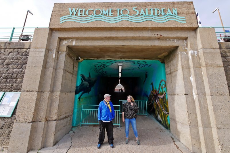David Wilson and Bridget Fishleigh, Brighton & Hove's Only Elected Independent Councillor stand in front of the tunnel at Saltdean Lido