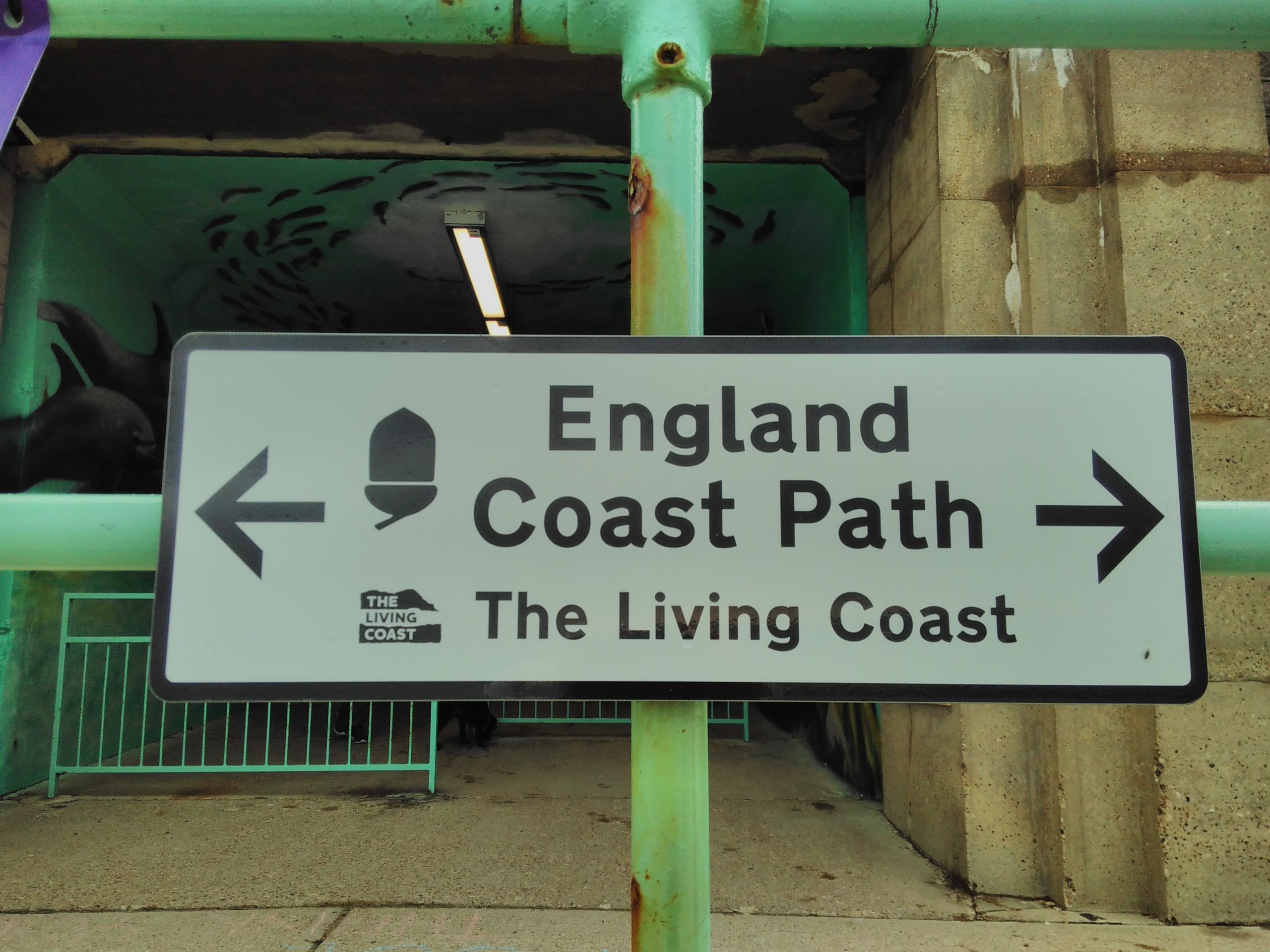One of the sign for the England Coast Path on the seafront of The Living Coast